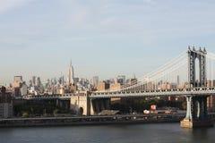 Empire state building, Manhattan Bridge. View of the Manhattan Bridge and Manhattan, from the Brooklyn Bridge stock photography