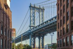 Empire State building through the Manhattan Bridge royalty free stock photography