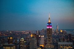 Empire State Building lit at sunset Stock Image