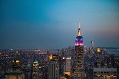 Empire State Building New York på skymning Fotografering för Bildbyråer