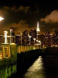 Empire State Building at Night From Queens. View of iconic skyscraper from Gantry Plaza State Park in Long Island City. Pier is in the foreground and the night Royalty Free Stock Images