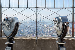 Empire State Building observation deck with binoculars in New York. NEW YORK - SEPTEMBER 10: Empire State Building observation deck with two binoculars in a Stock Photo