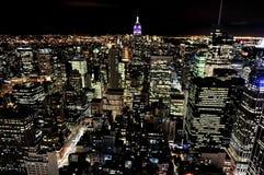 Empire State Building på natten i Manhattan New York Fotografering för Bildbyråer