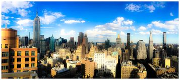 Empire State Building. Panoramic view of mid-town Manhattan in New York City including the iconic Empire State Building royalty free stock photography