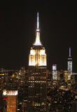 The Empire State Building in the skyline of New York at night stock photos