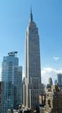 The empire state building. Stading tall midday royalty free stock images