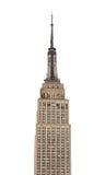 Empire State Building står ut mot plan vit himmel Arkivbild