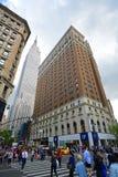 Empire State Building y Herald Towers, NYC Imagen de archivo libre de regalías