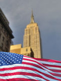 Empire state with flag. The famous empire state with american flag royalty free stock photos