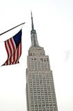 Empire states and american flag. Empire state building in new york and american flag royalty free stock photos