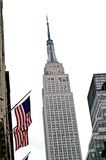 Empire states and american flags. Empire state building in new york and american flags royalty free stock images