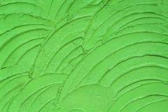 Emplastrando o muro de cimento verde colorido em testes padrões de onda sem emenda no fundo fotografia de stock
