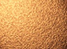 Emplastre a parede, a pedra, a textura marrom da iluminação ou o fundo Imagem de Stock Royalty Free