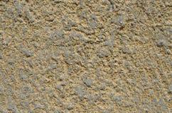 Emplastro amarelo na parede para o fundo Fotografia de Stock Royalty Free