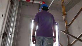 Emplazamiento de la obra de los controles del capataz o del inspector metrajes