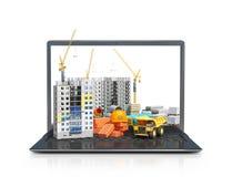 Emplazamiento de la obra en la pantalla de un ordenador portátil, edificio del rascacielos, materiales de construcción imagen de archivo libre de regalías