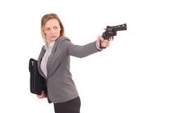 Empleado bonito con la arma de mano aislada en blanco imagen de archivo libre de regalías