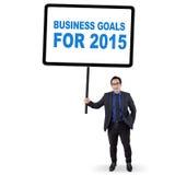 Empleado con las metas de negocio para 2015 Imagen de archivo