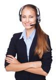 Empleado de sexo femenino joven del centro de llamada con el receptor de cabeza Fotos de archivo