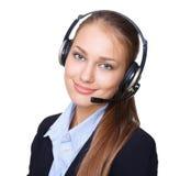 Empleado de sexo femenino joven del centro de llamada con un receptor de cabeza Foto de archivo libre de regalías