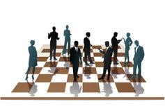 Empleados en un tablero de ajedrez Foto de archivo libre de regalías