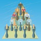 Empleados en una pirámide Fotos de archivo