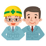 Empleados y jefe jovenes en ropa de trabajo Imagen de archivo libre de regalías