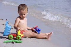 Emplear la playa Fotos de archivo libres de regalías