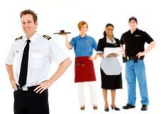 Empleos: Piloto alegre Stands With Group de empleados Imágenes de archivo libres de regalías