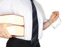 Employé de bureau avec les livres rouges Photo stock