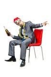 Employé de bureau ivre après fête de Noël Photographie stock libre de droits