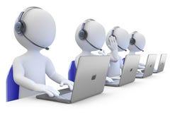 Employés travaillant à un centre d'attention téléphonique Images libres de droits