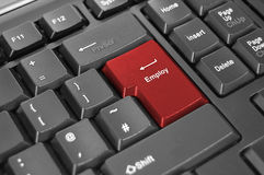 Employ enter keyboard. Image of a red enter key with the word employ Stock Image