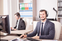 Employe from Customer service support working in the office. Employe from Customer service support working in office. Professional online and telephone assistant Stock Image