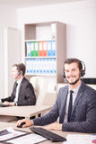 Employe from Customer service support working in the office. Employe from Customer service support working in office. Professional online and telephone assistant Stock Images