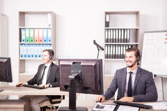 Employe from Customer service support working in the office. Employe from Customer service support working in office. Professional online and telephone assistant Royalty Free Stock Photography