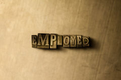 EMPLOYED - close-up of grungy vintage typeset word on metal backdrop Stock Images