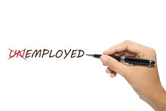 Employed. Hand holding pen changing text from unemployed to employed with an x on white background stock photo