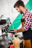 Employed pours coffee Stock Photos