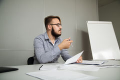Employee analyzes the contract and asks for clarification Royalty Free Stock Images