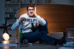 The employee asking for help and drinking under stress and despair. Employee asking for help and drinking under stress and despair Royalty Free Stock Photography