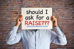 "Employee asking ""should I ask for a raise"", salary increase or negotiation concept stock photos"