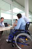 Employee in awheelchair Royalty Free Stock Image