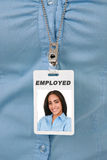 Employee Badge Close-up with Female Worker Photo Stock Image