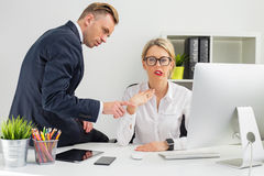 Employee being annoyed by her boss Stock Photos