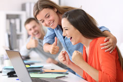Employee being congratulated by colleagues. Happy employee being congratulated by colleagues after success at office royalty free stock photo