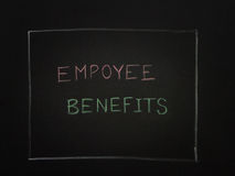 EMPLOYEE BENEFITS on black background. Stock Photo