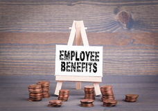 Employee Benefits, Business Concept. Miniature easel with small change Royalty Free Stock Photos