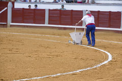Employee of the Bullring painting with a machine the white line of the bullring Stock Image
