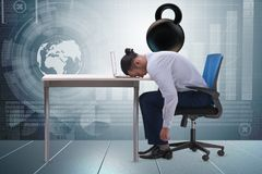 The employee with burden of work. Employee with burden of work royalty free stock photography